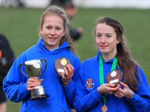 Sisters Ellie (left) and Hannah Hobbs with their gold and silver medals
